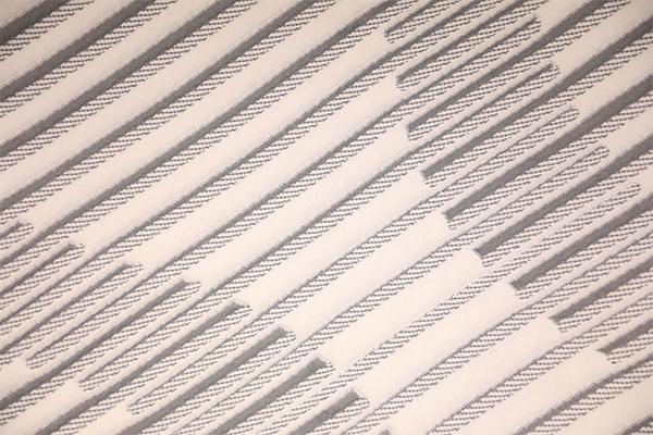 Capa de aire de punto suave a rayas